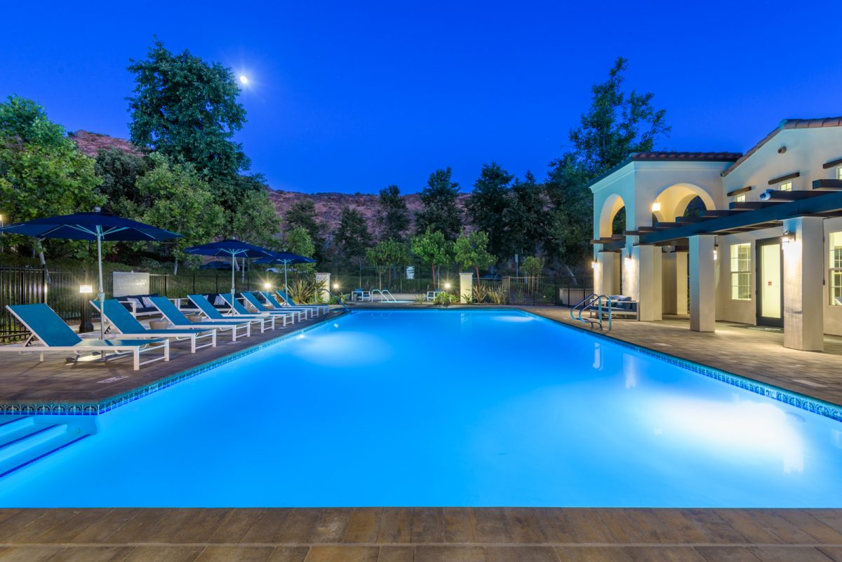Evening view of pool at a condo development